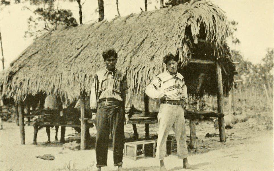 Florida, the Land of Enchantment - A Seminole Hut and Indian Youths (1918)
