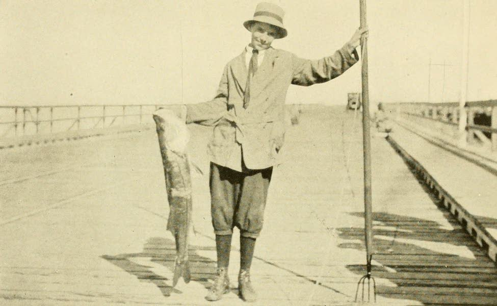 Florida, the Land of Enchantment - A Youthful Fisherman, his Catch and his Weapon (1918)