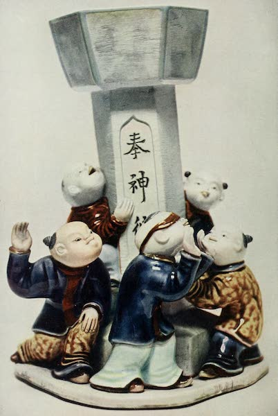 Japanese Porcelain - Group of Boys playing round a Lantern (1909)