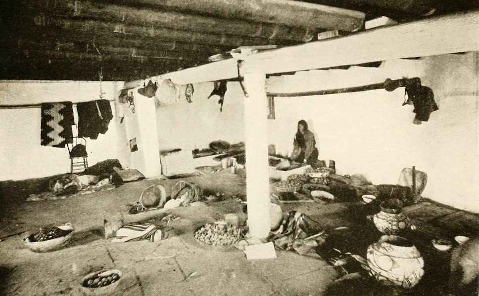 New Mexico, The Land of the Delight Makers - We-wha at the Grinding Trough in her house at Zuni (1920)