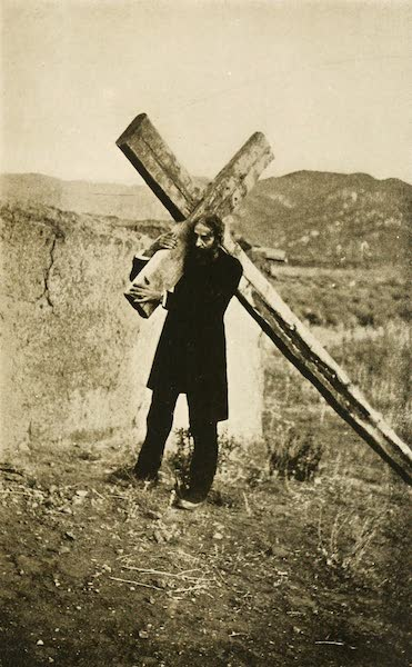 New Mexico, The Land of the Delight Makers - The Author attempting to carry a typical Penitente Cross (1920)