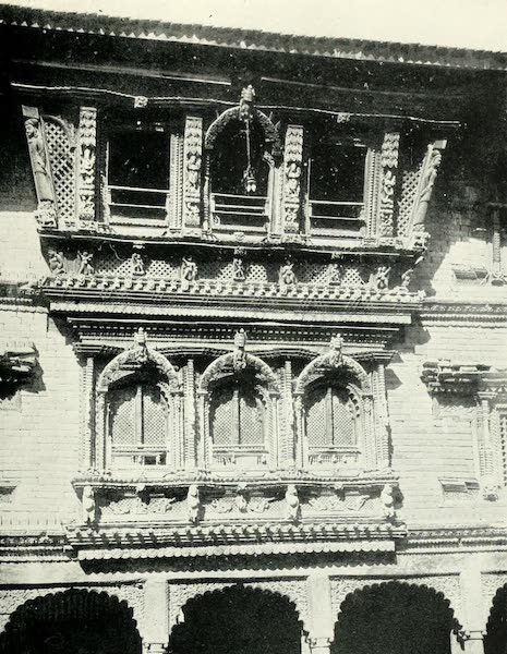 Picturesque Nepal - Windows richly ornamented with Carved Woodwork in the Courtyard of the Temple of Changu-Narain (1912)