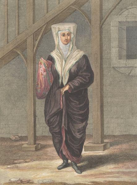 Femme Suive Courtiere qui porte ses Marchandises