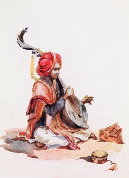 Southern India, Painted and Described - A Hindu Musician playing on a Tambour (1914)