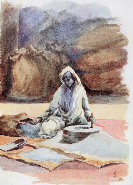 Southern India, Painted and Described - A Canarese Woman grinding Millet (1914)