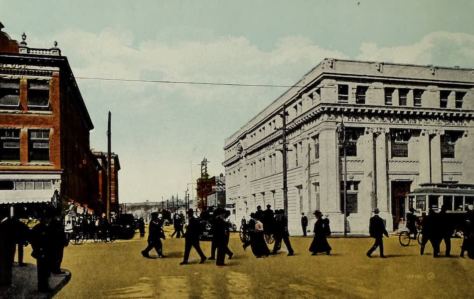 Souvenir of Calgary, Alta. - Corner First Street East and 8th Avenue, showing Dominion Bank Buildings (1912)
