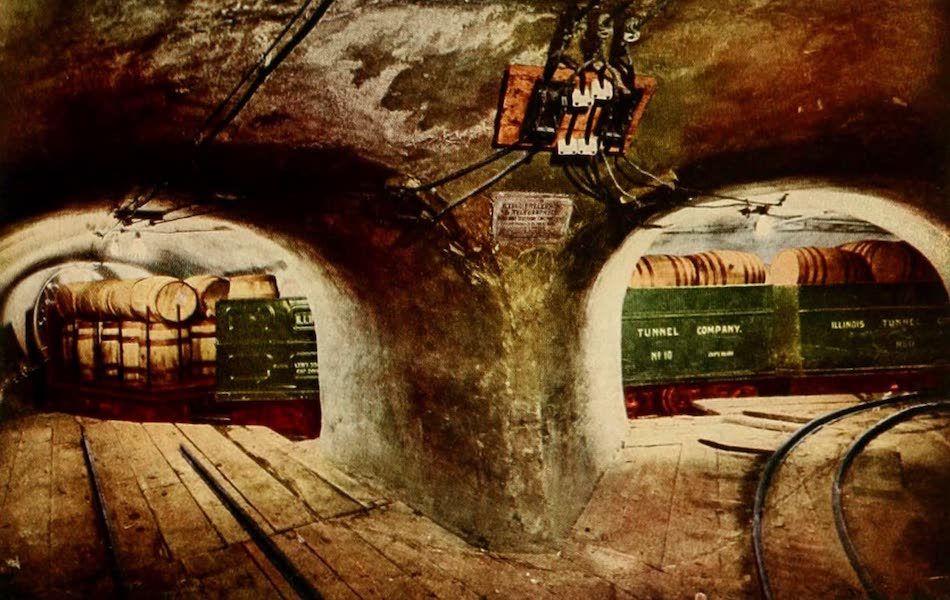 Souvenir of Chicago in Colors - Underground Tunnel at Street Intersection, Showing Loaded Freight Cars (1910)