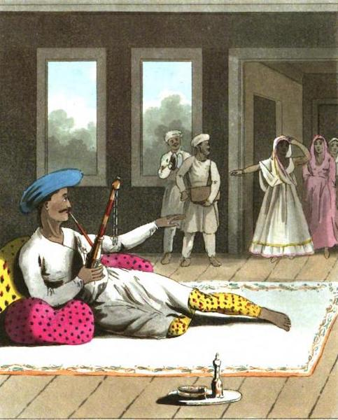 The European in India - A Native Gentleman Smoking a Goorgoory, or Hookah, in hi private Apartments, attended by his Dancing Girls. (1813)