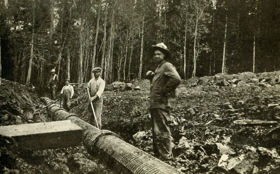 Utah, the Land of Blossoming Valleys - Laying Irrigation Pipes, Powell National Forest (1922)