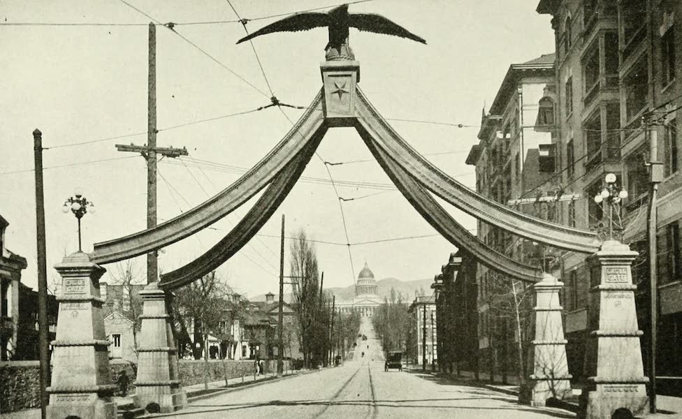 Utah, the Land of Blossoming Valleys - Eagle Gate, with the State Capitol in the Background, Salt Lake City (1922)